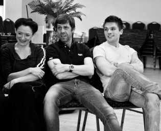 cast relaxing in rehearsals
